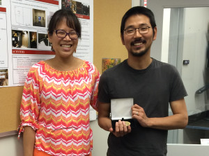 Dr. Wang and Joonhee Lee with Newman Medal